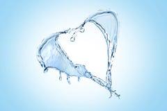 Coeur d'éclaboussure de l'eau Photos stock
