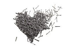 Coeur d'amour fait de clous de fer Photographie stock libre de droits