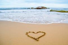 Coeur d'amour sur la plage Photos stock
