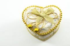 Coeur d'or sur un fond blanc Images stock