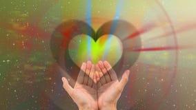 Coeur dans des mains Photos libres de droits