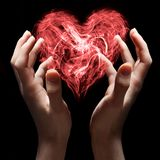 Coeur dans des mains Images libres de droits