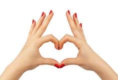 Coeur dans des mains sur le fond blanc d'isolement Image stock