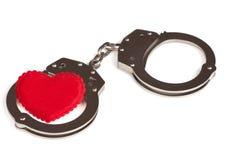 Coeur dans des menottes Photos libres de droits