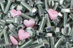 Coeur dans des vis Photos stock