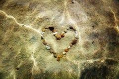 Coeur dans l'eau Photo stock