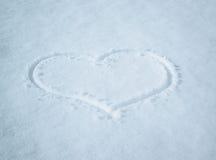Coeur dans la neige Photos libres de droits