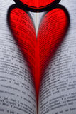 Coeur dans le livre Photo libre de droits