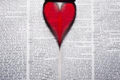 Coeur dans le livre Image stock