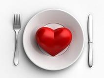 Coeur dans le plat Image stock