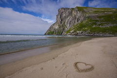 Coeur dans le sable Photo stock