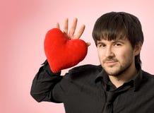 Coeur dans sa main Photos libres de droits