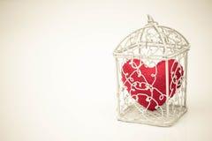 Coeur dans une cage Images libres de droits