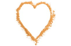 Coeur de cannelle orange d'isolement sur le fond blanc Photographie stock libre de droits