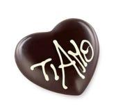 Coeur de chocolat avec l'AMO de TI Photographie stock libre de droits