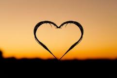 Coeur de coucher du soleil Images stock