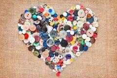 Coeur de couture de boutons Photographie stock libre de droits