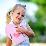 Coeur de fixation d'enfant Photo stock