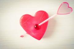 coeur de flèche percé Image stock