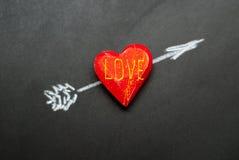 coeur de flèche percé Photographie stock