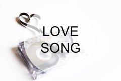 Coeur de forme de bande de cassette sonore de l'OM de fond de chanson d'amour Images libres de droits