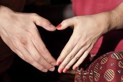 Coeur de forme de mains Photographie stock libre de droits