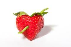 Coeur de fraise avec la chenille de flèche Photo stock
