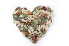 Coeur de graine de citrouille, de tournesol et de tomates sèches Images libres de droits