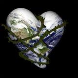 Coeur de la terre enveloppé avec des épines Photographie stock libre de droits