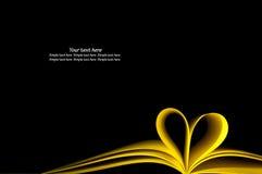 Coeur de livre jaune et de forme Photographie stock libre de droits