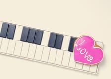 Coeur de mélomane sur le ton de vintage de clavier Photos libres de droits