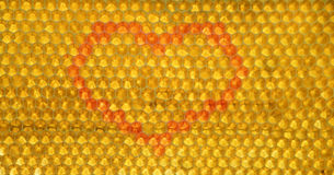 Coeur de miel dans des peignes Photos libres de droits