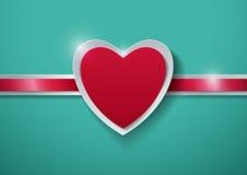 Coeur de papier sur le fond de turquoise Photo stock