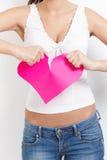 Coeur de papier violent femelle fâché à part Photographie stock