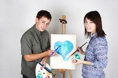 Coeur de peinture d'homme et de fille Photographie stock libre de droits