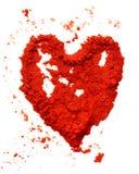 Coeur de poudre de poivron rouge Photographie stock