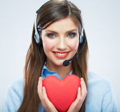 Coeur de rouge de symbole d'amour de prise d'opérateur de centre d'appels de femme Fin vers le haut Image libre de droits