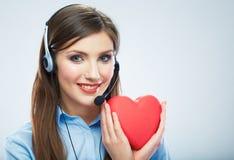Coeur de rouge de symbole d'amour de prise d'opérateur de centre d'appels de femme Fin vers le haut Images stock
