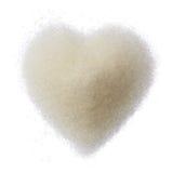 Coeur de sucre d'isolement sur le fond blanc Photographie stock libre de droits