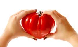 Coeur de tomate d'amour Photo stock