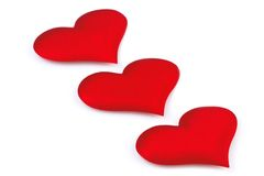 Coeur de trois rouges d'isolement sur le blanc Images stock