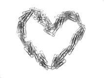Coeur de trombone symbolisant l'amour des affaires Image stock
