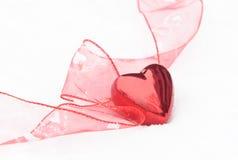 Coeur de Valentines dans la neige Images libres de droits
