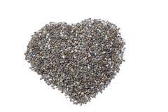 Coeur des graines de chia Images stock