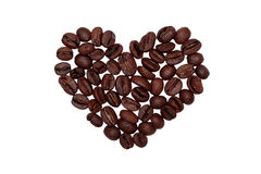 Coeur des grains de café sur d'isolement Photos stock