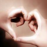 Coeur des mains Photographie stock
