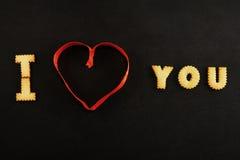 Coeur des textes I vous sur le noir Photo libre de droits