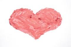 Coeur dessiné dans le rouge à lèvres sur un fond blanc Image libre de droits