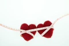 Coeur deux avec la bande de mesure Photographie stock libre de droits