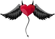 Coeur diabolique avec des klaxons et des ailes Photographie stock